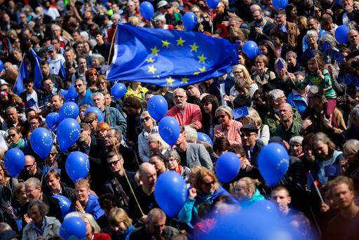 Supporters wave European flags during a pro-Europe rally organised by the Pulse of Europe movement in Berlin, Germany, yesterday. Photo: AP