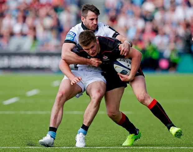 Owen Farrell of Saracens attempts to break away from Tommy Seymour of Glasgow Warriors Photo: Reuters / Henry Browne