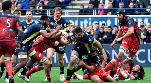 Clermont French flanker Damien Chouly (centre) vies for control of the ball Photo: THIERRY ZOCCOLAN/AFP/Getty Images