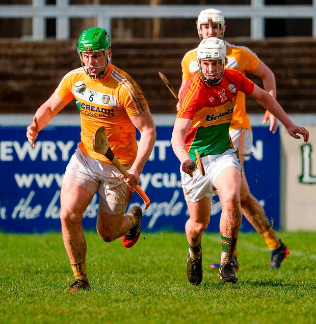 Antrim's Matthew Donnelly in action against Carlow's Kevin McDonald. Photo: Oliver McVeigh/Sportsfile