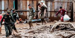 Soldiers help to evacuate locals following mudslides caused by heavy rains in Mocoa, in southern Colombia. Photo: AFP/Getty