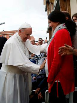 Pope Francis blesses a pregnant woman after meeting the people affected by the earthquake in Mirandola, Italy. Photo: Reuters