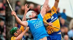 Aron Shanagher of Clare soars to make a great catch ahead of Dublin's Liam Rushe during yesterday's Allianz HL Division 1A play-off. Photo: Diarmuid Greene/Sportsfile