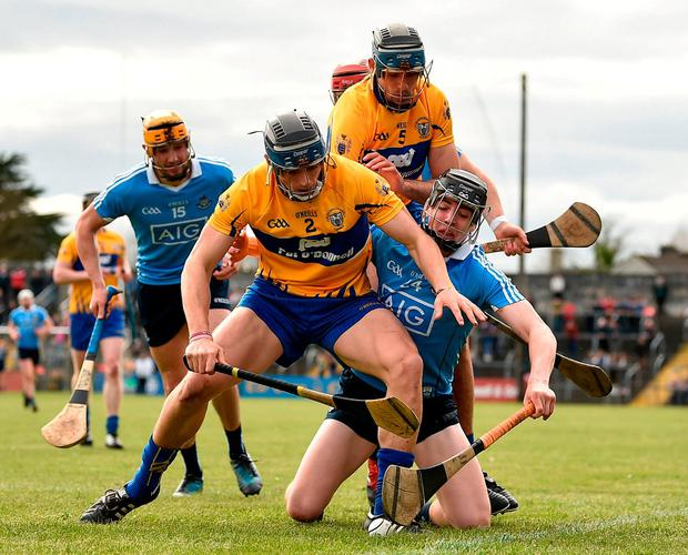 Clare's David McInerney and Brendan Bugler in action against Dublin's Donal Burke and Eamon Dillon. Photo: Diarmuid Greene/Sportsfile