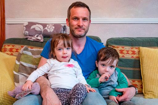 David Rafferty and his twins Sam and Penny. Photo: Arthur Carron
