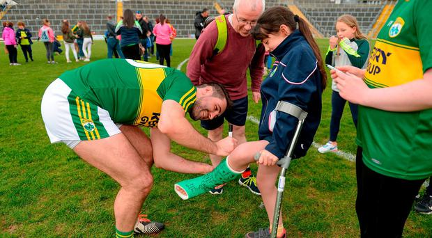 After overcoming Tyrone at Fitzgerald Stadium, Kerry's Bryan Sheehan signs the cast of Kelly Anne Nix, aged 12, from Castleisland, Co Kerry, who broke her leg playing Gaelic football. Photo: Cody Glenn/Sportsfile