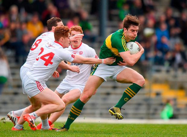 Kerry's David Moran in action against, from left, Tyrone's Colm Cavanagh, Conor Meyler and Peter Harte. Photo: Cody Glenn/Sportsfile