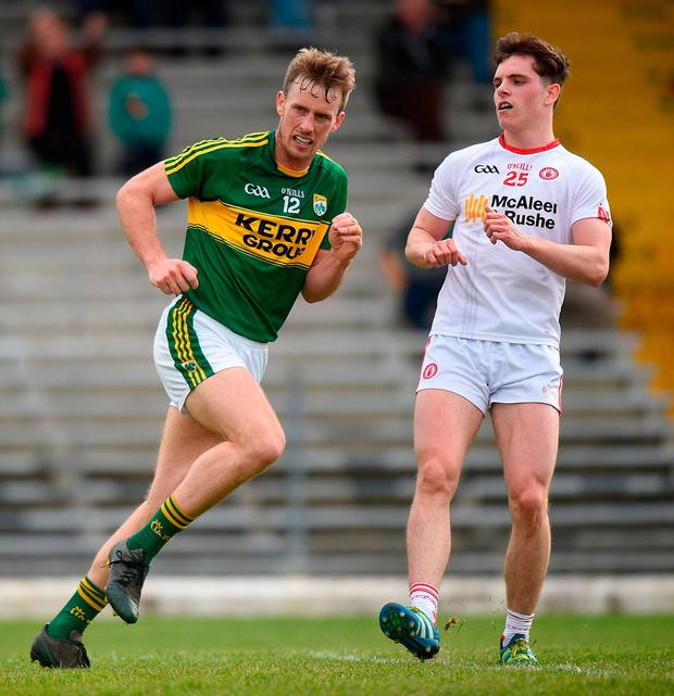 Kerry's Donnchadh Walsh wheels away past Tyrone's David Mulgrew. Photo: Cody Glenn/Sportsfile