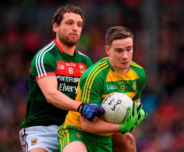 Donegal's Ciaran Thompson in action against Mayo's Tom Parsons. Photo: Stephen McCarthy/Sportsfile