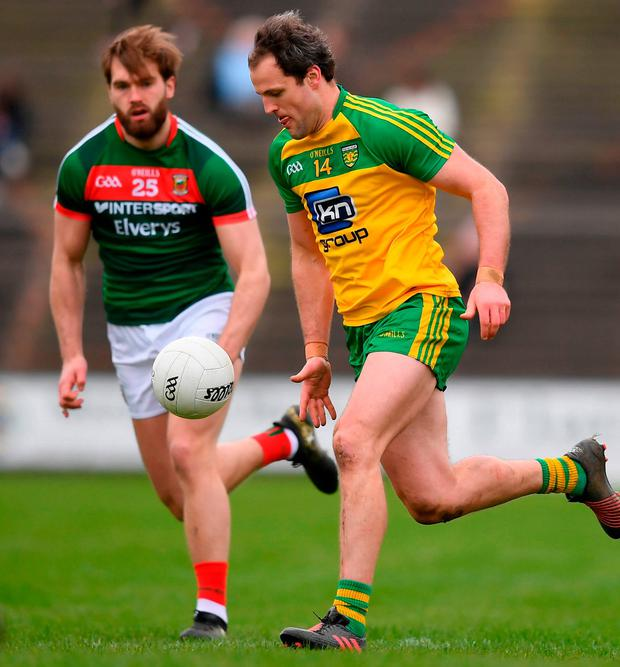 Donegal's Michael Murphy in action against Mayo's Aidan O'Shea. Photo: Stephen McCarthy/Sportsfile