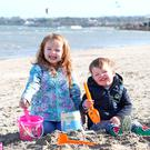 Sarah (4) and Charlie Foxton (2) on Sandymount Beach in Dublin. Photo: Stephen Collins