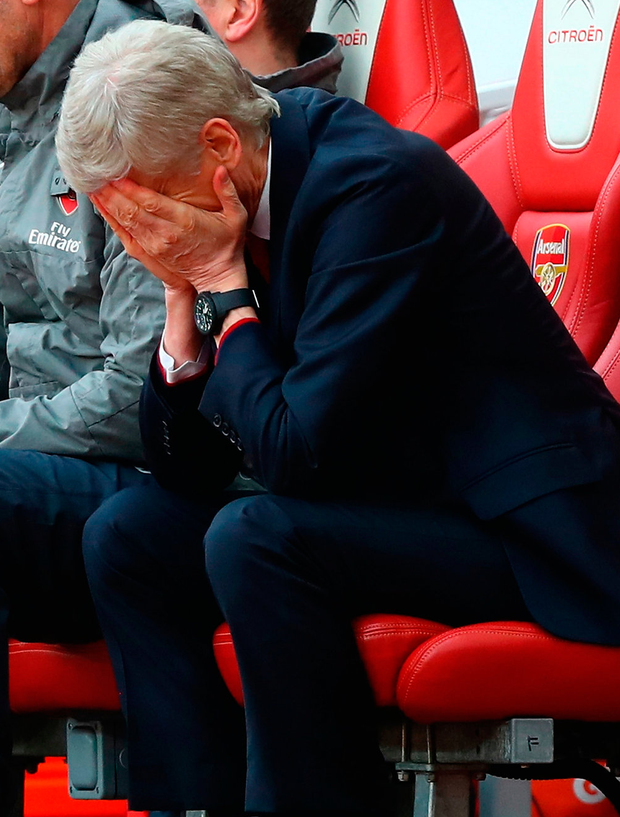 Arsene Wenger looks dejected during the match Photo: Clive Rose/Getty Images