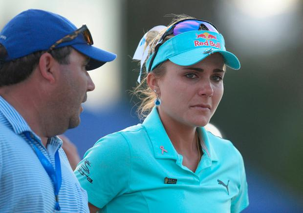 Lexi Thompson reacts following her loss in playoff against So Yeon Ryu during the final round of the ANA Inspiration golf tournament at Mission Hills