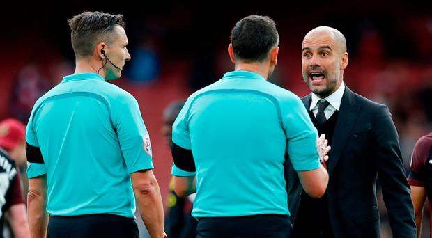 Manchester City manager Pep Guardiola speaks to referee Andre Marriner at full time yesterday