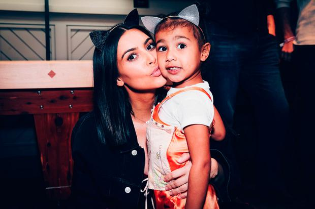 Kim Kardashian and daughter, North West on March 31, 2017 in Inglewood, California. (Photo by Rich Fury/Forum Photos via Getty Images)