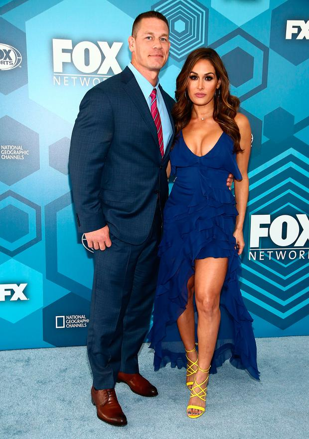 (L-R) John Cena and Nikki Bella attend FOX 2016 Upfront Arrivals at Wollman Rink, Central Park on May 16, 2016 in New York City. (Photo by Astrid Stawiarz/Getty Images)