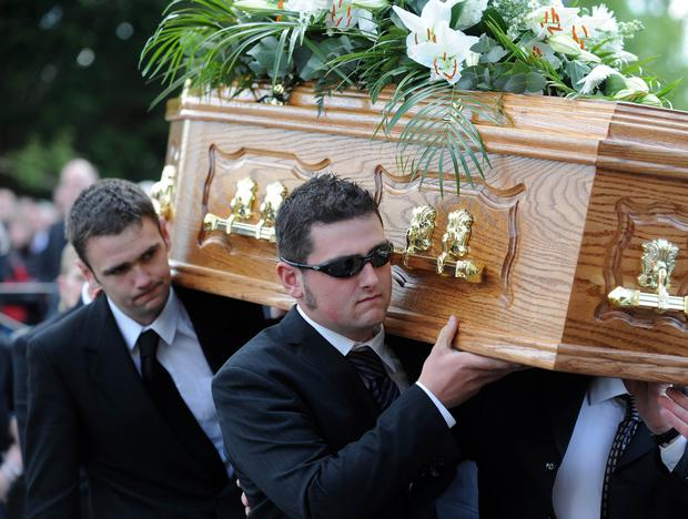 Robert Dunlop's sons William and Michael carry his coffin at Garryduff Presbyterian Church