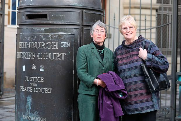 Carol Rohan Beyts, with Sue Edwards (right) outside Edinburgh Sheriff Court, who has been permitted to pursue damages against Donald Trump's Aberdeenshire golf course over allegations that staff filmed her urinating (Andrew Milligan/PA Wire)