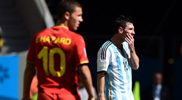 Argentina's forward Lionel Messi (R) reacts in front of Belgium's midfielder Eden Hazard during the second half of a quarter-final football match between Argentina and Belgium at the 2014 FIFA World Cup. AFP PHOTO / FRANCOIS XAVIER MARIT (Photo credit should read FRANCOIS XAVIER MARIT/AFP/Getty Images)