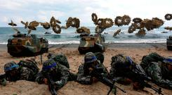 South Korean marines participate in a landing operation referred to as Foal Eagle in a joint military exercise with US troops on the Pohang seashore on Sunday. Photo: Getty