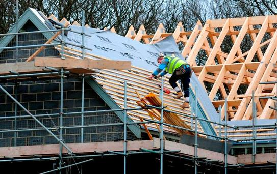 A man works on the roof of a new home. First-time buyers can avail of a €20,000 tax rebate on purchases of new builds. Photo: PA