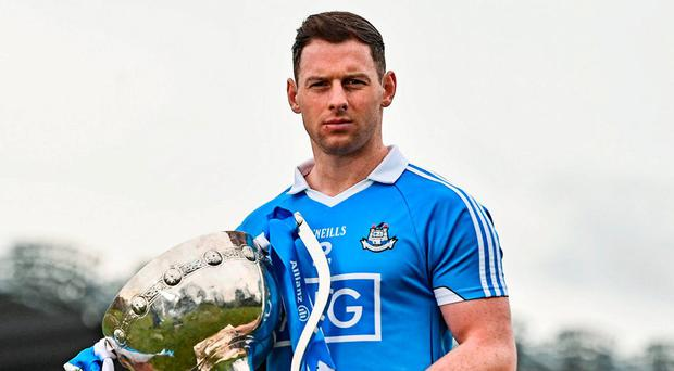 Philly McMahon will be hoping to get his hands on the Allianz NFL Division 1 trophy once again when Dublin play Kerry on Sunday. Photo: Ramsey Cardy/Sportsfile