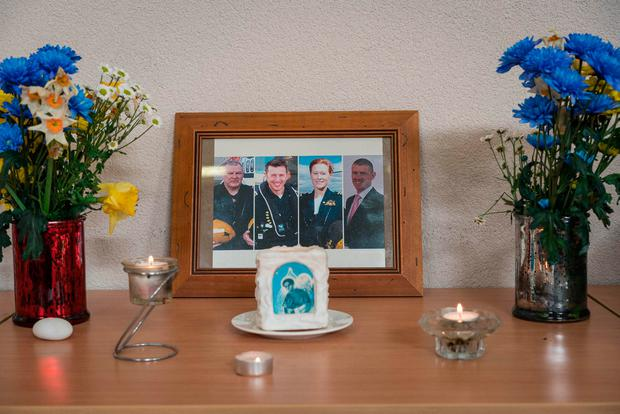 A photograph in a shrine for the crew of the Coast Guard helicopter in the community centre in Aughleim, Co Mayo. Photo: Keith Heneghan