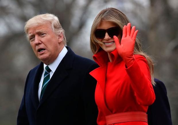 U.S. President Donald Trump (L) and First Lady Melania Trump (R) prepare to depart the White House on March 17, 2017 in Washington, DC. President Trump is spending the weekend at his Mar-a-Lago estate in Florida. (Photo by Justin Sullivan/Getty Images)