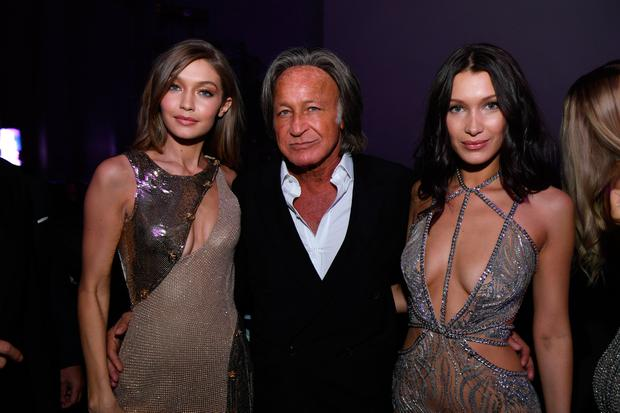 (L-R) Gigi Hadid, Mohamed Hadid and Bella Hadid attend the Victoria's Secret After Party at the Grand Palais on November 30, 2016 in Paris, France. (Photo by Dimitrios Kambouris/Getty Images for Victoria's Secret)