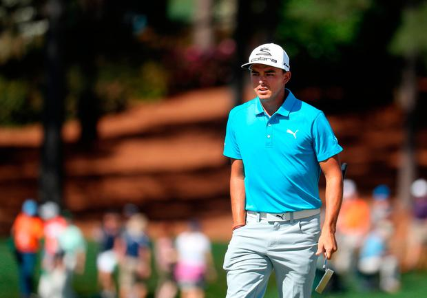 Rickie Fowler waits on the on the ninth hole during a practice round prior to the start of the 2017 Masters. Photo: Getty Images