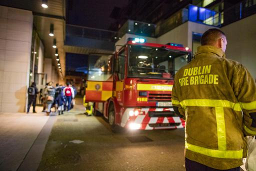 Residents go back into their apartments after Dublin Fire brigade tend a fire at an apartment at the Cubes in the Beacon South Quarter in Sandyford. Picture:Arthur Carron