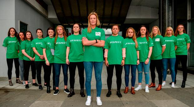 Captain Emma Byrne with some of her international team-mates at Liberty Hall. Photo: CODY GLENN/SPORTSFILE