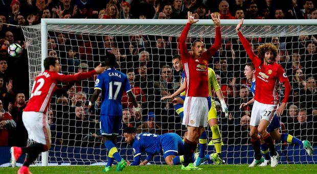 Manchester United's Zlatan Ibrahimovic, Henrikh Mkhitaryan and Marouane Fellaini appeal after Everton's Ashley Williams handles the ball in the area