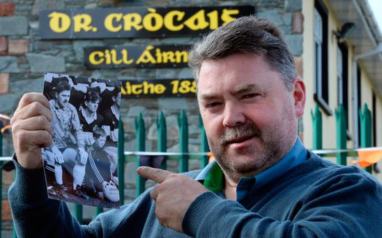 Former Dr Crokes keeper Peter O'Brien with a photo of himself as goalie and Colm Cooper as team mascot in 1992 Photo: Don MacMonagle
