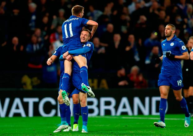 Leicester City's Jamie Vardy celebrates scoring his sides second goal with Marc Albrighton. Photo: PA