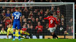 Zlatan Ibrahimovic converts from the spot to secure a 1-1 draw at Old Trafford. Photo: REUTERS