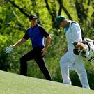 Rory McIlroy shares a joke with caddie JP Fitzgerald at Augusta yesterday. Photo: Charlie Riedel/AP Photo