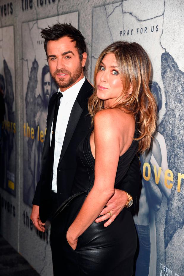 Actors Justin Theroux and Jennifer Aniston attend the premiere of HBO's