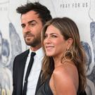 Jennifer Aniston, right, and Justin Theroux arrive at the LA Premiere of