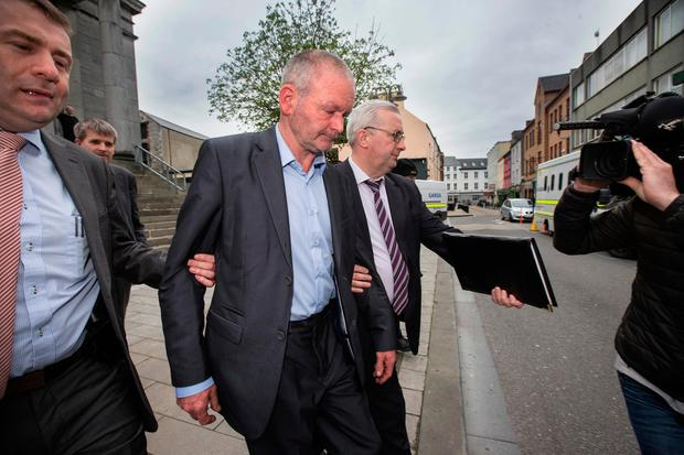 Michael Ferris (centre) who appeared at Tralee District Court this morning charged with murder. Pic:Mark Condren