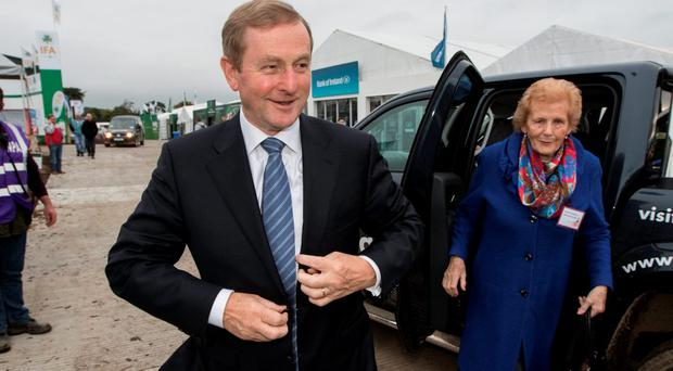 Taoiseach Enda Kenny with Anna May McHugh arriving to the 2015 National Ploughing Championships in Ratheniska, County Laois. Pic:Mark Condren.