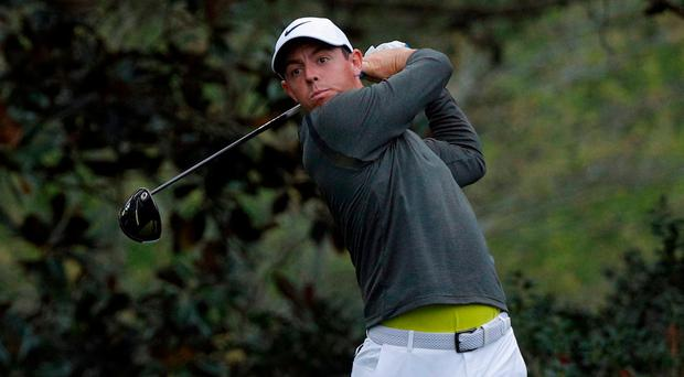 Rory McIlroy of Northern Ireland tees off on the 15th hole during Wednesday practice rounds for the 2017 Masters at Augusta National Golf Club in Augusta