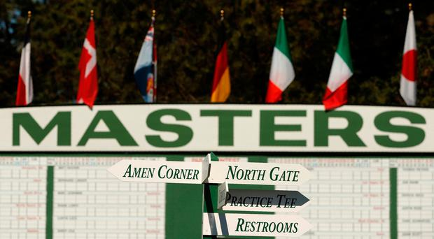 Direction signs are posted near a scoreboard on the first fairway at Augusta National Golf Course in Augusta, Georgia