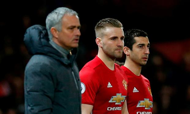 Manchester United's Luke Shaw and Henrikh Mkhitaryan wait to come on as substitutes as manager Jose Mourinho looks on last night