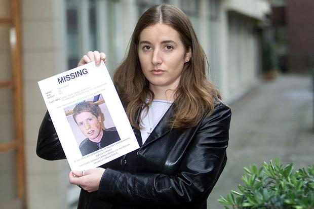 Michelle Deely holding a photo of her missing brother Trevor. Photo: Collins