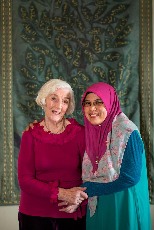 Nor Nasib and Ann Madden standing in front of the 99 Names of Allah at the Chester Beatty Library. Photo: Fergal Phillips
