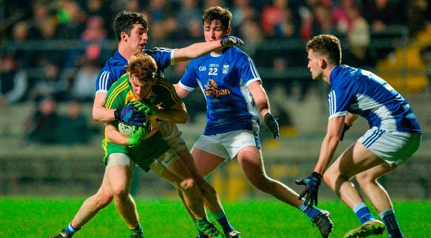 Lorcan Connors of Donegal in action Cavan's, from left, Pierce Smith, Patrick O'Reilly and Donal Monahan during the EirGrid Ulster GAA Football U21 Championship Semi-Final match between Cavan and Donegal at Brewster Park in Enniskillen, Co Fermanagh. Photo by Piaras Ó Mídheach/Sportsfile