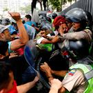 Demonstrators scuffle with security forces during an opposition rally in Caracas, Venezuela. Photo: Reuters