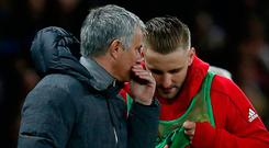 Luke Shaw receives instructions from manager Jose Mourinho before coming on against Everton. Photo: Reuters