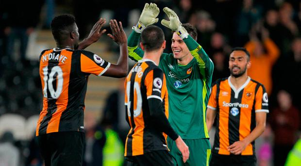 Hull City's Alfred N'Diaye (left) and goalkeeper Eldin Jakupovic celebrate after their victory over Middlesbrough at the KCOM Stadium. Photo: PA